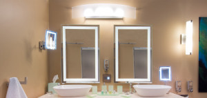 Hotel bathroom with lighted magnified mirrors