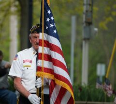 Veteran with American flag