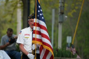 Veteran with American flag